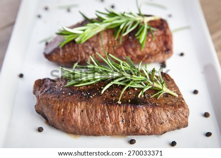 Roasted beef fillet with rosemary - stock photo
