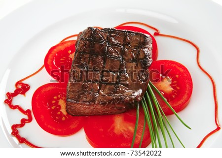 roasted beef meat served with tomato on plate - stock photo