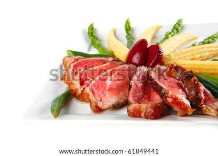 roasted beef served with beans and corns on plate