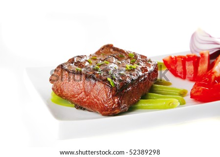 roasted beef served with tomato on white plate - stock photo