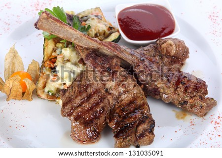 roasted beef steak on a white plate
