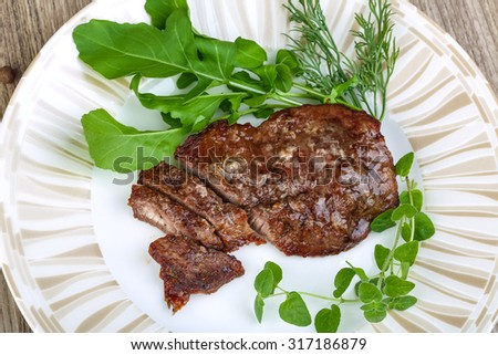 Roasted beef steak with dill, ruccola and spices