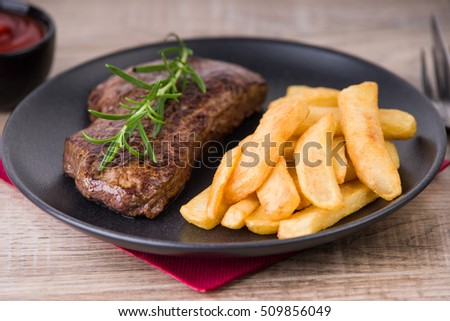 Roasted beef steak with french fries