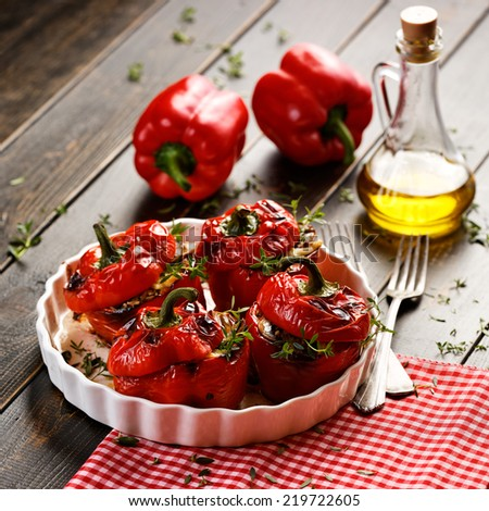 Roasted bell peppers stuffed with rice and mushrooms - stock photo