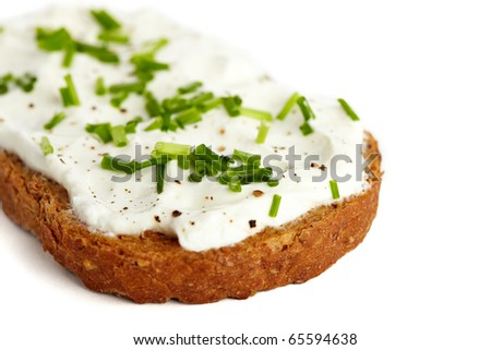 Roasted bread with cream cheese and chives, isolated on white - stock photo