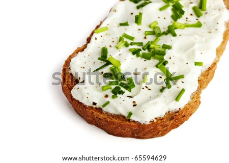 Roasted bread with curd and chives, isolated on white - stock photo