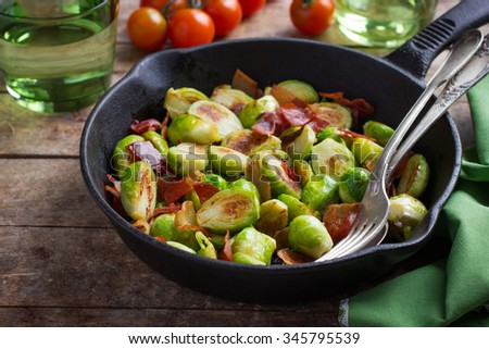 roasted brussels sprouts with bacon, selective focus - stock photo