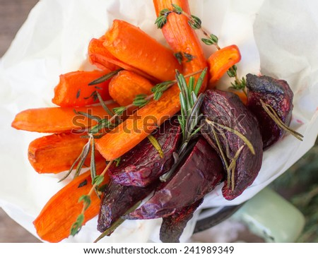 roasted carrots and beets with thyme and rosemary - stock photo