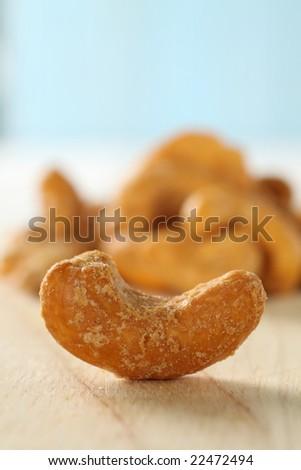 roasted cashew nut isolated on wooden background. - stock photo