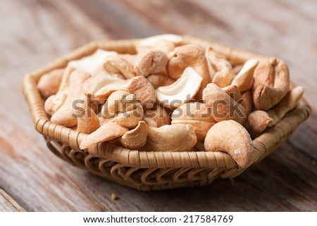 Roasted cashews on wooden table - stock photo