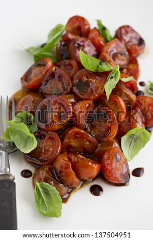 Roasted Cherry Tomatoes with Basil and Balsamic Vinegar.