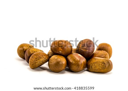 roasted Chestnuts isolated on white. - stock photo