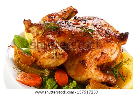 Roasted chicken and vegetables on white background