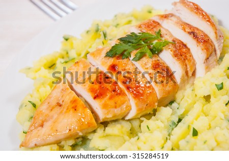 Roasted chicken breast and mashed potatoes