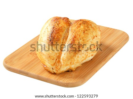 Roasted chicken breast on cutting board - stock photo