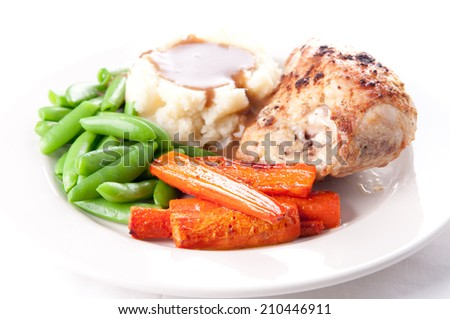 roasted chicken breast with mashed potatoes, gravy and fresh vegetables - stock photo