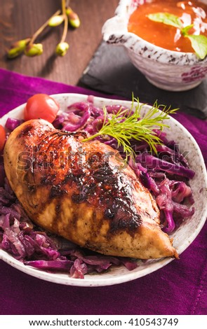 Roasted chicken breast with stewed red cabbage on plate