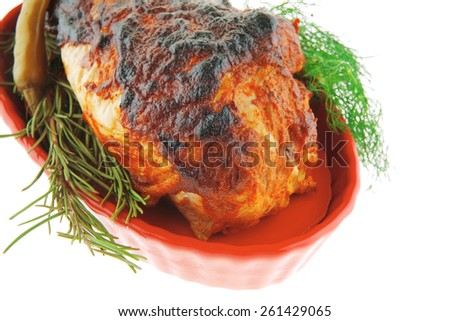 roasted chicken drumstick on red bowl over white - stock photo