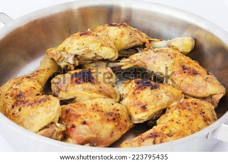 Roasted Chicken Drumsticks on a Baking Pan, Fresh out of the Oven. - stock photo