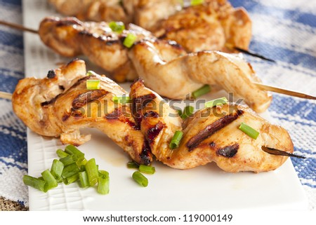 Roasted Chicken Kebab on a wooden skewer - stock photo