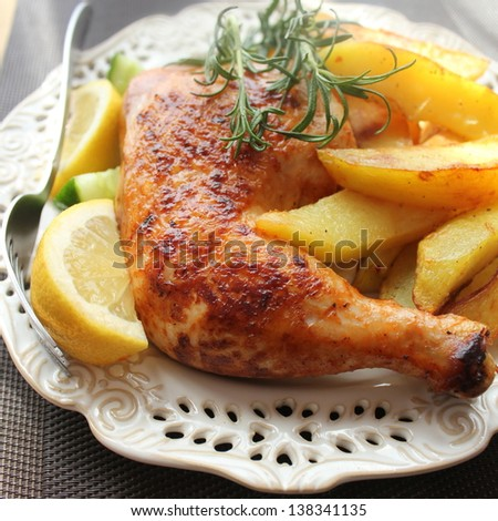 roasted chicken leg with fries potato and lemon - stock photo