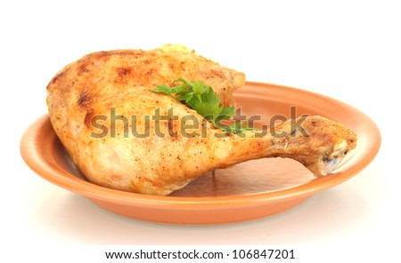 roasted chicken leg with parsley in the plate isolated on white - stock photo