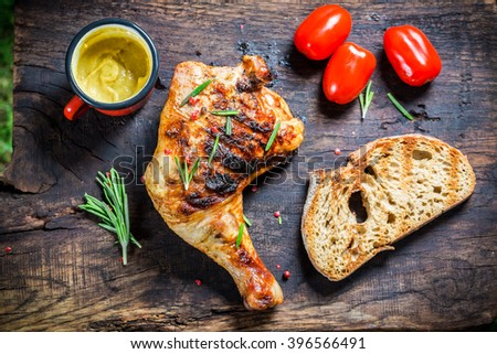 Roasted chicken leg with toast and cherry tomato - stock photo