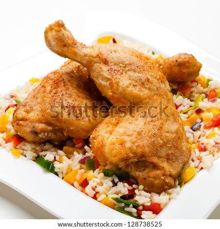 Roasted chicken legs and vegetables - stock photo