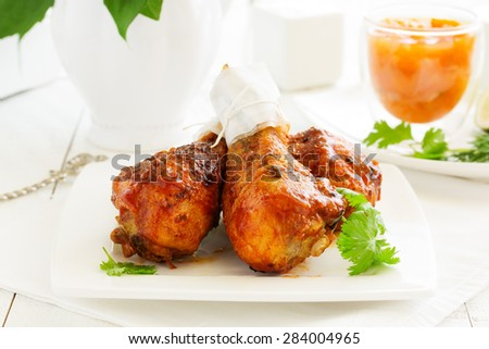Roasted chicken legs with barbecue sauce with mango chutney.