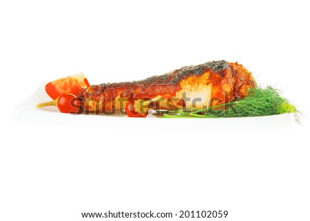 roasted chicken legs with greenery on white background - stock photo