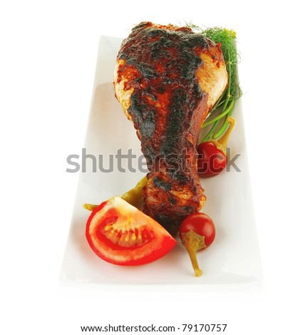 roasted chicken legs with greenery on white background