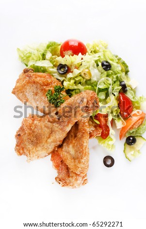 Roasted chicken legs with salad
