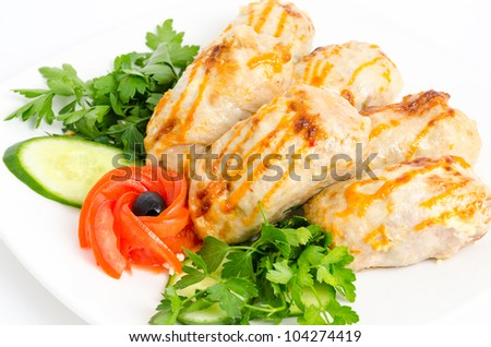 roasted chicken rolls served with fresh vegetables