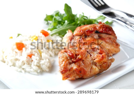 Roasted chicken snack on white background, shallow focus - stock photo