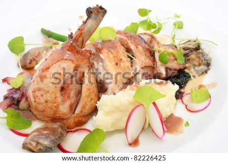 Roasted Chicken Thigh with salad isolated on white - stock photo