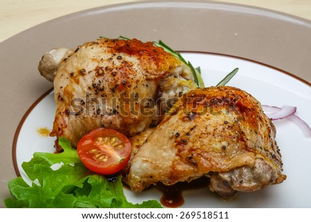 Roasted chicken thighs with herbs and spices - stock photo