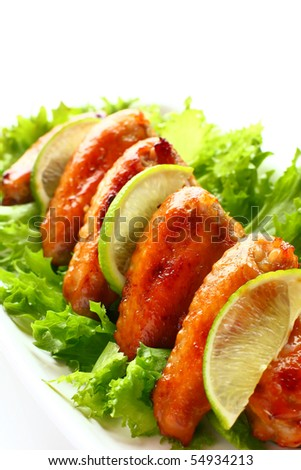 roasted chicken wings with salad