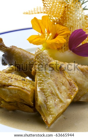 Roasted chicken with elegant garnish and cream sauce. - stock photo