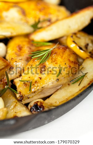 Roasted Chicken with Garlic, Lemon and Rosemary. Selective focus.