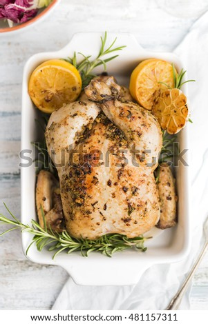 Roasted chicken with lemons and rosemary