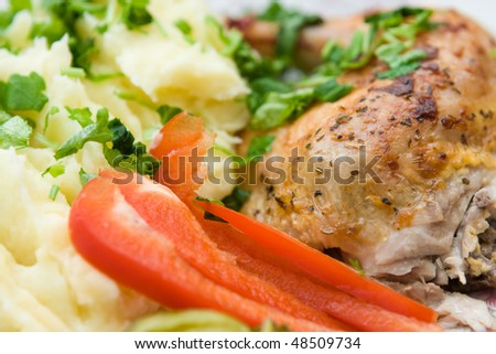 roasted chicken with mash potato and pepper close up - stock photo