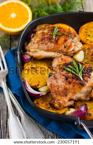 Roasted chicken with oranges and herbs - stock photo
