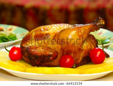 Roasted chicken with pineapple slices and red peppers