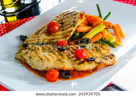 Roasted chicken with vegetables. - stock photo