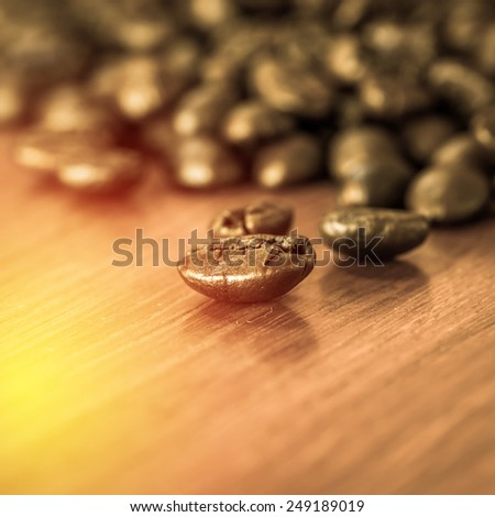 Roasted coffee bean on wooden table.