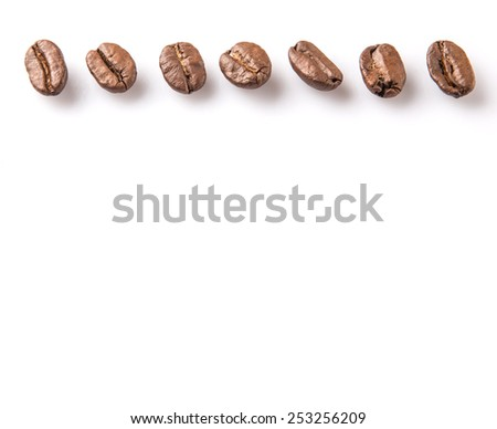 Roasted coffee bean over white background