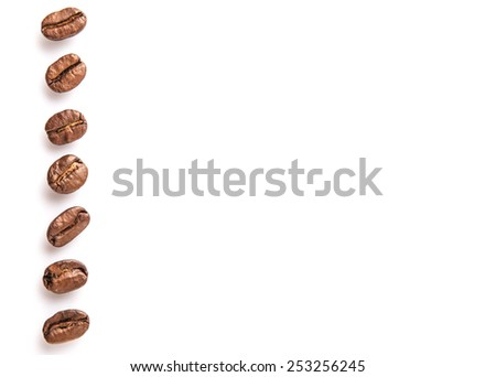 Roasted coffee bean over white background - stock photo