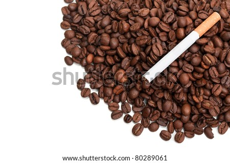 Roasted coffee beans and cigarettes isolated on a white background