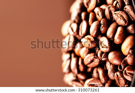 Roasted Coffee Beans background texture. Brown coffee beans for background and texture with copyspace for text dark chocolate color - stock photo