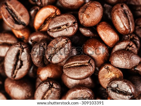 Roasted coffee beans, can be used as a background.  Coffee beans texture macro  - stock photo